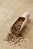 Oriental spice mixture in a wooden scoop