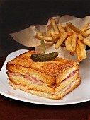 Grilled Double Decker Ham and Cheese Sandwich with a Pickle; French Fries