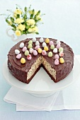 Cheesecake with chocolate chips, chocolate glaze and sugar eggs