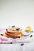 Stack of Pancakes Topped with Lemon Curd, Fresh Blueberries and Dusted with Powdered Sugar