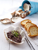 Tapenade with toasted sliced of bread