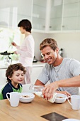 A family eating breakfast in a kitchen