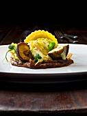 Ravioli filled with asparagus and pecorino on lemon butter with shiitake mushrooms