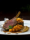 Braised shoulder of lamb with sesame seed pumpkin, aubergine mousse, pomegranate syrup and cumin sauce