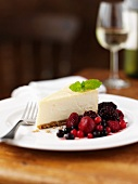 A slice of cheesecake with berry compote