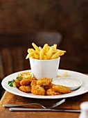 Bread, fried prawns with a dip and chips