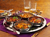 Four different types of curries on a tray (India)