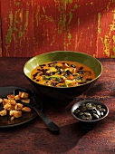 Pumpkin soup with curry, leek, pumpkin seeds and croutons