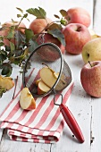 Whole apples and apple wedges in a sieve