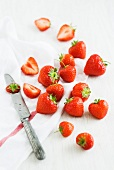 Strawberries, a tea towel and a knife