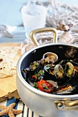 Mussel and clam antipasto with cherry tomatoes and white wine