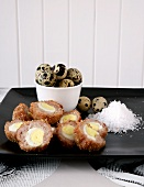Scotch eggs (egg wrapped in sausage meat and coated in breadcrumbs, England)