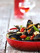 Steamed mussels with tomatoes, ginger and feta cheese