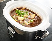 Beef Stew with Peas and Potatoes in a Slow Cooker