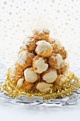 Croquembouche (Christmas dessert, France) with Christmas cake