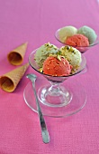 Pistachio and strawberry ice cream with chopped pistachios