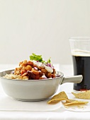Vegetable Chili Served Over Rice with Tortilla Chips and a Glass of Beer