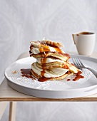 Plate of coconut pancakes with cream