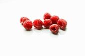 Eight Fresh Raspberries on White Background