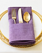 A Place Setting with a Purple Napkin