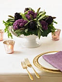 Table Centerpiece Made from Purple Artichokes and Cauliflower