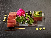 Tuna tataki and tartar arrange on slices of sea bass and tuna