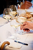 Glasses of white wine and a degustation form