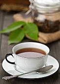 A cup of walnut leaf tea