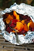 Vegetables wrapped in tin foil for grilling