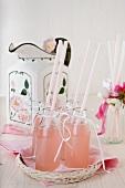 Homemade rhubarb lemonade in small bottles