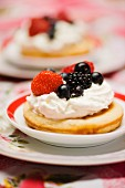 Pancake with berries and whipped cream