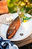 Smoked kipper with herb schnapps, crisp bread and butter