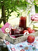 Apple punch on a table in a summery garden