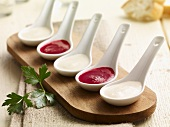 Kohlrabi and beetroot sauce on porcelain spoons