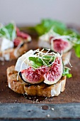 Toasted bread topped with figs and soft cheese