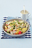 Potato salad with turnips, cucumber, herbs and a cream dressing