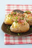 Baked potatoes with garlic puree and pancetta