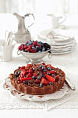 Chocolate cake topped with berries