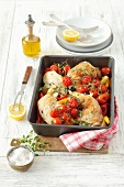 Chicken legs with peppers and cherry tomatoes