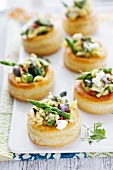 Vol-au-vents with asparagus, scrambled egg, oyster mushrooms and goat's cheese