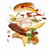 A burger falling apart