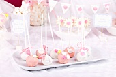 Cake pops with sugar roses and sugar leaves