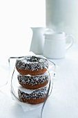 Doughnuts with flaked coconut, stacked and tied together