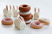 Assorted doughnuts and Easter bunnies made from paper