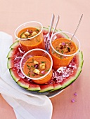 Three cups of gazpacho in a watermelon