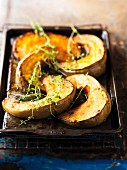 Roasted squash wedges on a baking tray