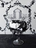 White fondant layer cake with a black ribbon