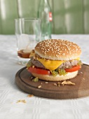 A cheeseburger with cucumber relish and a glass of cola – hangover breakfast