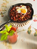 Chilli con carne with a fried egg - hangover breakfast