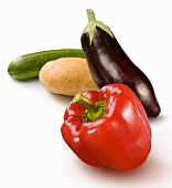 A pepper, an aubergine, a potato and an courgette